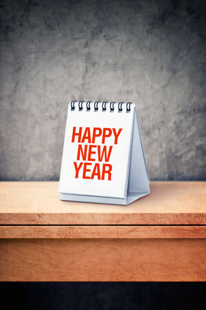 Happy New Year on desk calendar at office table. New Year photo
