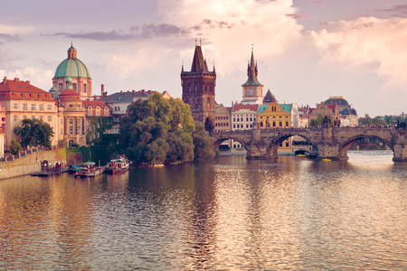 Charles Bridge and spires of the Prague Old Town at the banks of river Vltava
