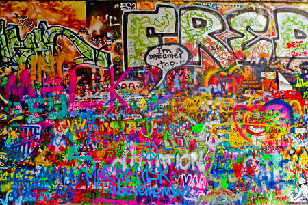 PRAGUE, CZECH REPUBLIC - SEPTEMBER 11, 2014: Famous John Lennon Wall on Kampa Island in Prague is filled with Beatles inspired graffiti and pieces of lyrics since the 1980s. Graffities are drawn on daily basis. Éditoriale