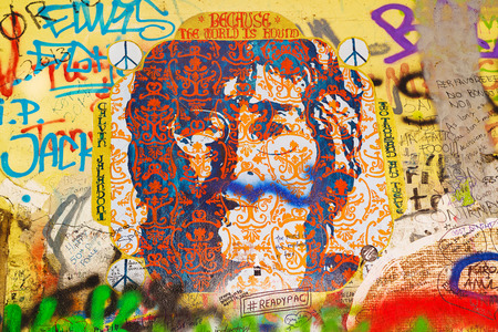 PRAGUE, CZECH REPUBLIC - SEPTEMBER 11, 2014: Famous John Lennon Wall on Kampa Island in Prague is filled with Beatles inspired graffiti and pieces of lyrics since the 1980s. Graffities are drawn on daily basis.