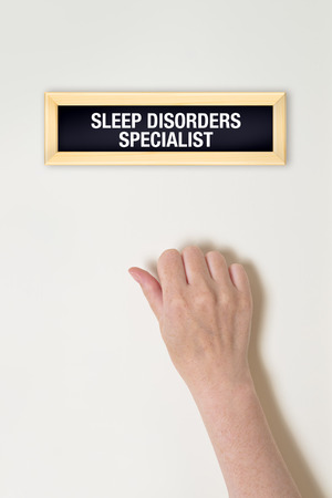 sleep disorder: Female hand is knocking on Sleep Disorder specialist door for a medical exam