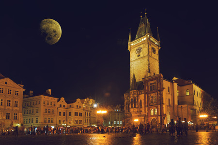 old town hall: Prague Old Town Hall at Night with unrecogizable tourists walking Editorial