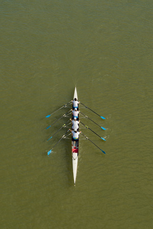 NOVI SAD, SERBIA - OCTOBER 18, 2014: Four women rowing on Danube River in Novi Sad on traditional remote regatta competition.