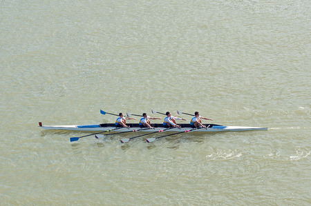 NOVI SAD, SERBIA - OCTOBER 18, 2014: Four men rowing on Danube River in Novi Sad on traditional remote regatta competition. 에디토리얼