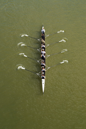 NOVI SAD, SERBIA - OCTOBER 18, 2014: Four men rowing on Danube River in Novi Sad on traditional remote regatta competition. Editorial