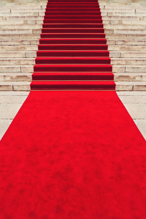 Red carpet on staircase marking the route taken by vips and celebrities on ceremonial events