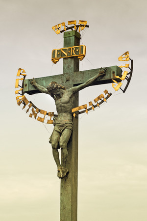 Monument of Jesus Christ crucifixion at Charles Bridge in Prague with the Hebrew reading King of the Jews dating from 17th century photo