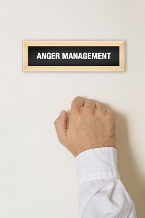 anger management: Male hand knocking on the door of Anger Management practice.