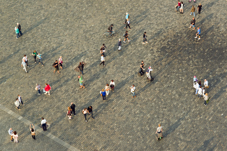 group direction: PRAGUE, CZECH REPUBLIC - SEPTEMBER 9, 2014: Tourists at Prague Old Town square walking in different directions Editorial