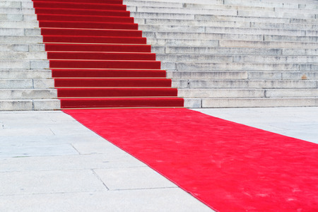 red carpet event: Red carpet on staircase marking the route taken by celebrities on ceremonial events Stock Photo
