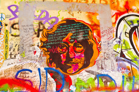 PRAGUE, CZECH REPUBLIC - SEPTEMBER 11, 2014: Famous John Lennon Wall on Kampa Island in Prague is filled with Beatles inspired graffiti and pieces of lyrics since the 1980s. Graffities are drawn on daily basis. 新闻类图片