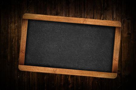 blank slate: Blank Slate on Brown wood planks as background.