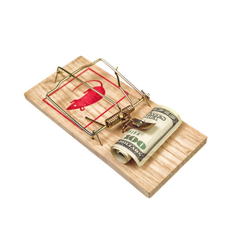Hundred Dollars Bill in Mouse Trap over white background photo