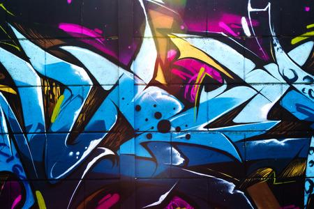 Street art graffiti, vibrant multicolor detail of graffiti art on the wall.