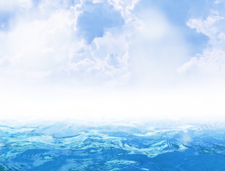 vast: Blue sea with waves and sky with clouds as backdrop