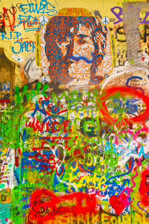 john lennon: PRAGUE, CZECH REPUBLIC - SEPTEMBER 11, 2014: Famous John Lennon Wall on Kampa Island in Prague is filled with Beatles inspired graffiti and pieces of lyrics since the 1980s. Graffities are drawn on daily basis. Editorial
