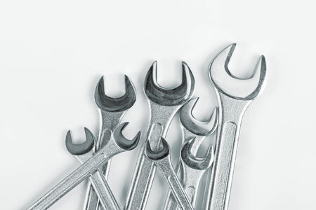 fix jaw: Wrench Jaw Spanner Tools Piled on workshop table. Stock Photo