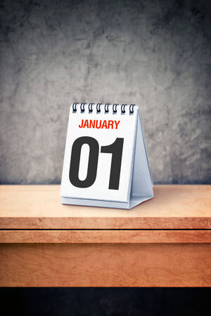 first day: January the 1st on desk calendar at office table. Happy New Year.