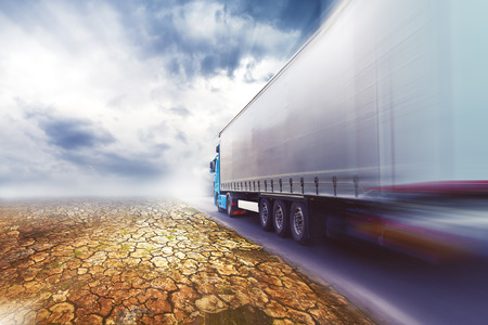 Speeding Transportation Truck driving on the road through the desert.