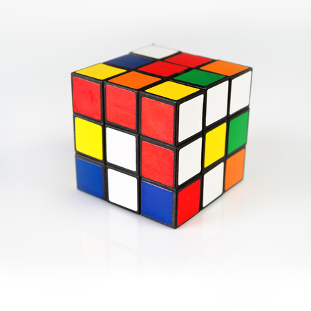 NOVI SAD, SERBIA - NOVEMBER 17, 2014: Rubiks Cube invented by a Hungarian architect Erno Rubik in 1974 is famous is 3 dimensional puzzle originally called Magic Cube. Редакционное