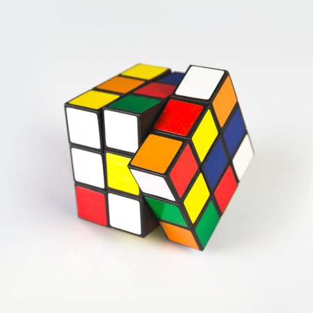 unsolved: NOVI SAD, SERBIA - NOVEMBER 17, 2014: Rubiks Cube invented by a Hungarian architect Erno Rubik in 1974 is famous is 3 dimensional puzzle originally called Magic Cube. Editorial