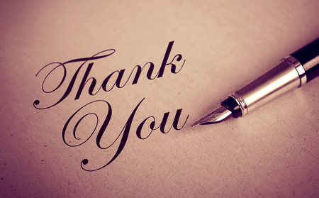 Foutain Pen and Thank You message on old paper textured background