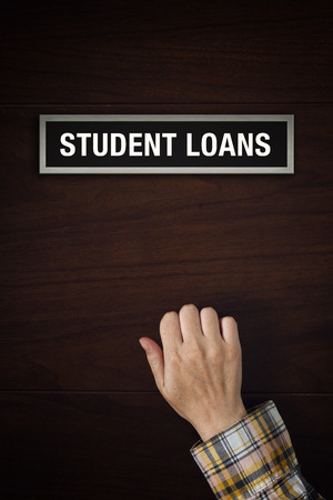 knocking: Female hand is knocking on Student Loans door, conceptual image.