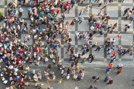 from above: PRAGUE, CZECH REPUBLIC - SEPTEMBER 9, 2014: Large group of tourists at Prague central square looking up to Old Town Hall tower.