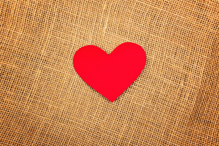jute texture: Valentines Day background with red paper hearts on natural jute burlap texture as copy space. Stock Photo