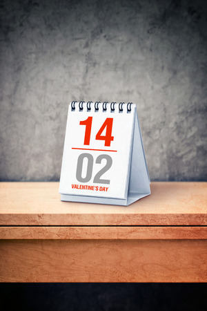 upcoming: Valentine day date concept - February 14th on desk calendar at office tableas a reminder of upcoming holiday.