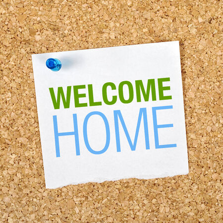 gratifying: Welcome Home Message on Reminder Paper pinned to a Cork Memory Board