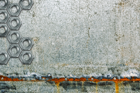 coated: Zinc coated galvanized steel metal sheet plate with bolt nuts and rusty edges. Stock Photo