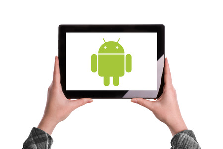 illustrative editorial: Novi Sad, Serbia - January 02, 2015: Hands Holding Digital Tablet Computer with Android Logo displayed on the screen. Illustrative editorial image isolated on white background. Editorial