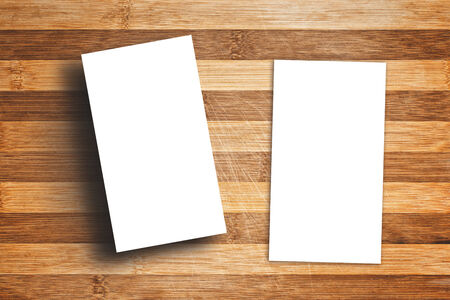 business cards: Blank Vertical Business Cards as copy space for your design on Wooden Table