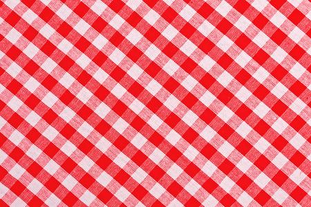 赤と白の市松模様テーブル クロス パターン テクスチャの背景として 写真素材
