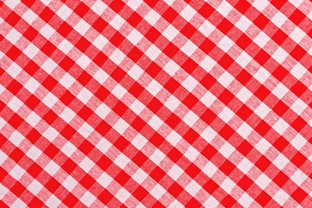 Red and white checkered tablecloth pattern texture as background Standard-Bild