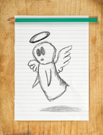 good judgment: Doodle drawing of angel on white paper with pencil, moraliser concept.