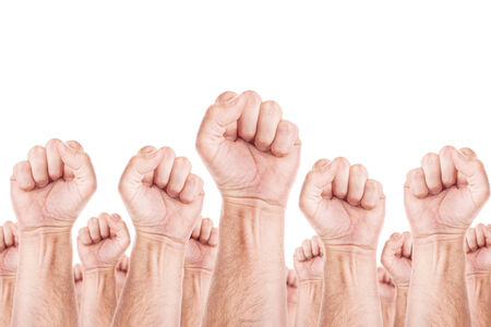boycott: Labour movement, workers union strike concept with male fists raised in the air fighting for their rights. Isolated on white background. Stock Photo