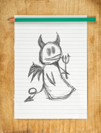 immoral: Doodle drawing of devil on white paper with pencil, moraliser concept. Stock Photo