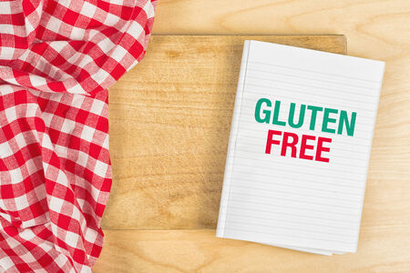 alergy: Gluten Free Food Message in Recipe Notebook on Kitchen Table Stock Photo