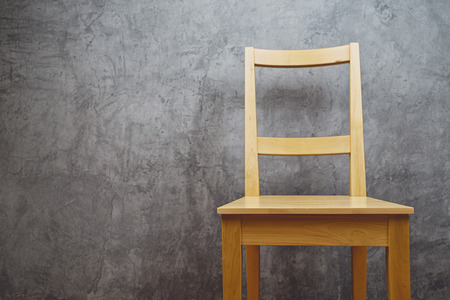 vintage chair: Empty Wooden Chair in room with grunge gray wall as copy space. Stock Photo