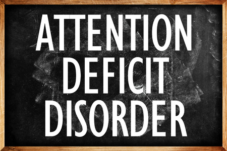 inattention: Attention Deficit Disorder Title on School Blackboard Stock Photo