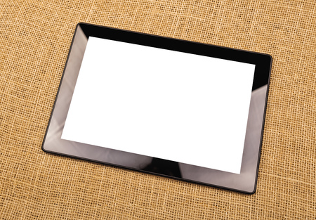 multi touch: Digital Tablet Computer with Blank White Screen as Copy Space on Office Desktop. Stock Photo