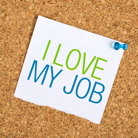pinned: I Love My Job Reminder Note Pinned to a Cork Memory Bulletin Board on Office Wall Stock Photo