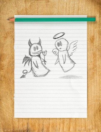 conscience: Doodle drawing of angel and devil on white paper as concept of conscience and moral dilemma in fight of good and evil.