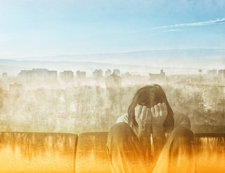 misery: Social Alienation Concept, Depressed Man covering face and crying in despair. Stock Photo