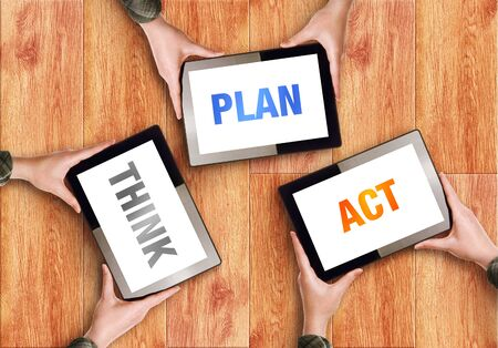 Think Plan Act Business Concept with Coworkers Hands holding Digital Tablet Coputers. photo