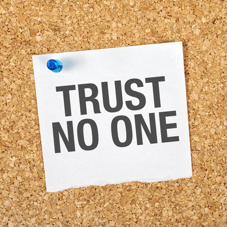 with no one: Trust No One Reminder Note Pinned to a Cork Memory Bulletin Board.