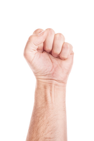 Labor movement, workers union strike concept with male fist isolated on white background raised in the air fighting for their rights.