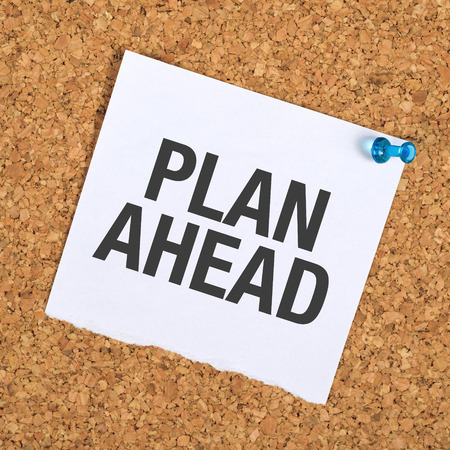 precedent: Plan Ahead Reminder Note Pinned to a Cork Memory Bulletin Board in Business Office